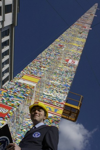 Guinness World Record judge Martinez stands in front of the world's tallest standing Lego tower in Vienna